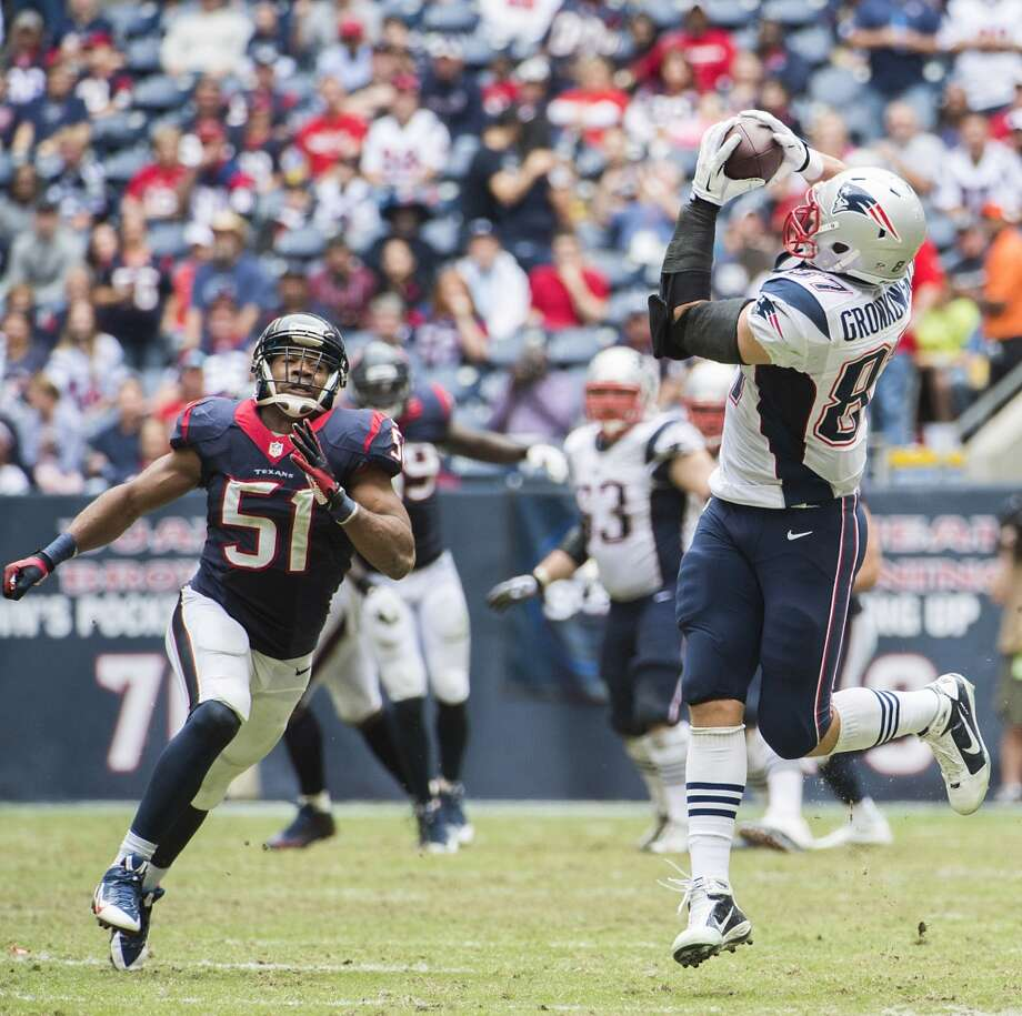Patriots tight end Rob Gronkowski (87) gets past Texans linebacker Darryl Sharpton to haul in a 50-yard pass during the second half. Photo: Smiley N. Pool, Houston Chronicle