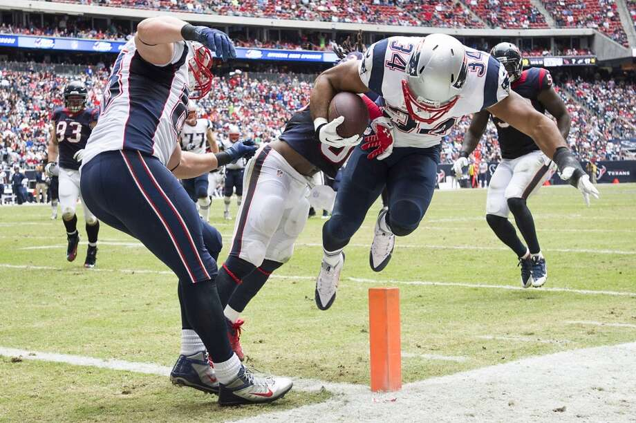 Patriots running back Shane Vereen (34) is stopped just short of a touchdown by Texans strong safety D.J. Swearinger during the second half. Photo: Smiley N. Pool, Houston Chronicle