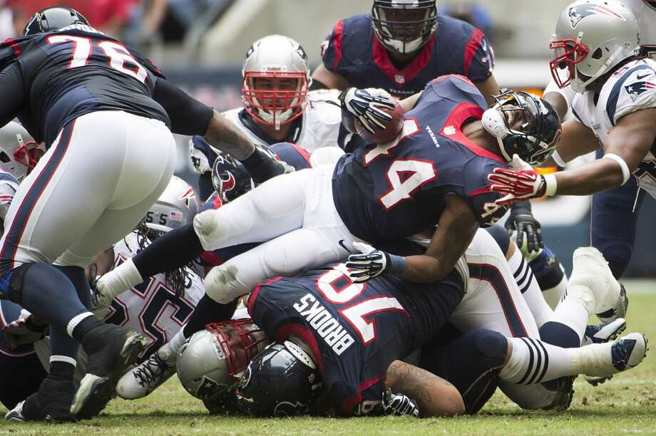 Texans running back Ben Tate (44) is brought down by the Patriots defense. Photo: Smiley N. Pool, Houston Chronicle