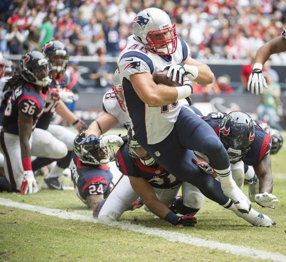 Patriots fullback James Develin scores on a 1-yard touchdown run. Photo: Smiley N. Pool, Houston Chronicle