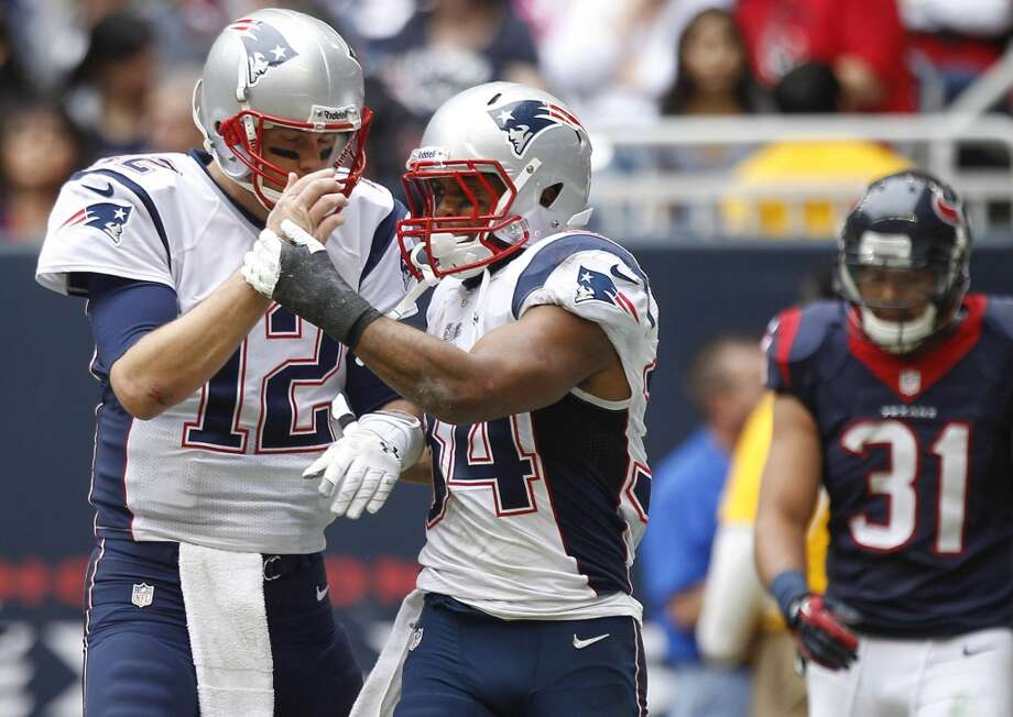 Patriots quarterback Tom Brady (12) and running back Shane Vereen (34) celebrate Vereen's 9-yard touchdown reception during the third quarter. Photo: Brett Coomer, Houston Chronicle