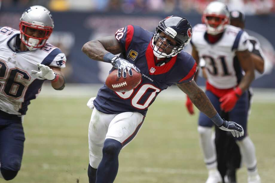 Texans wide receiver Andre Johnson tries to stay in-bounds as he runs along the sidelines after making a catch during the third quarter. Photo: Brett Coomer, Houston Chronicle