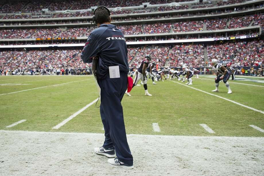 Texans head coach Gary Kubiak walks to the line of scrimmage before quarterback Case Keenum ran for 5-yard touchdown during the second half. Photo: Smiley N. Pool, Houston Chronicle