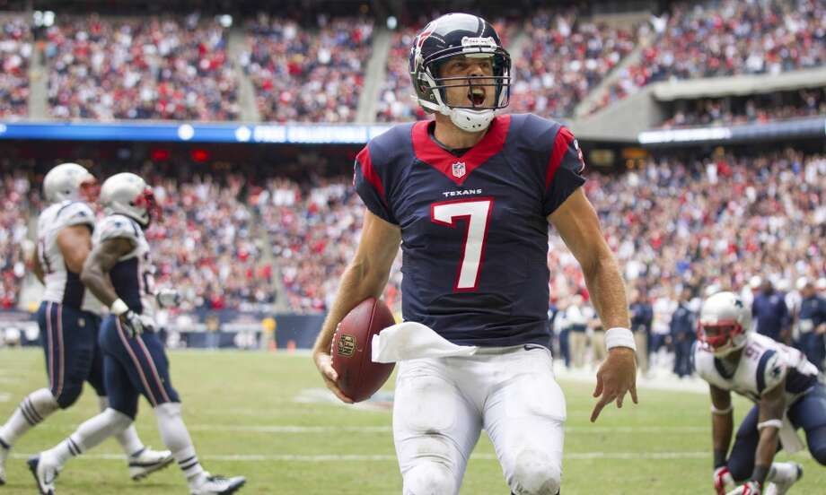 Texans quarterback Case Keenum celebrates his 5-yard touchdown run against the Patriots. Photo: Brett Coomer, Houston Chronicle