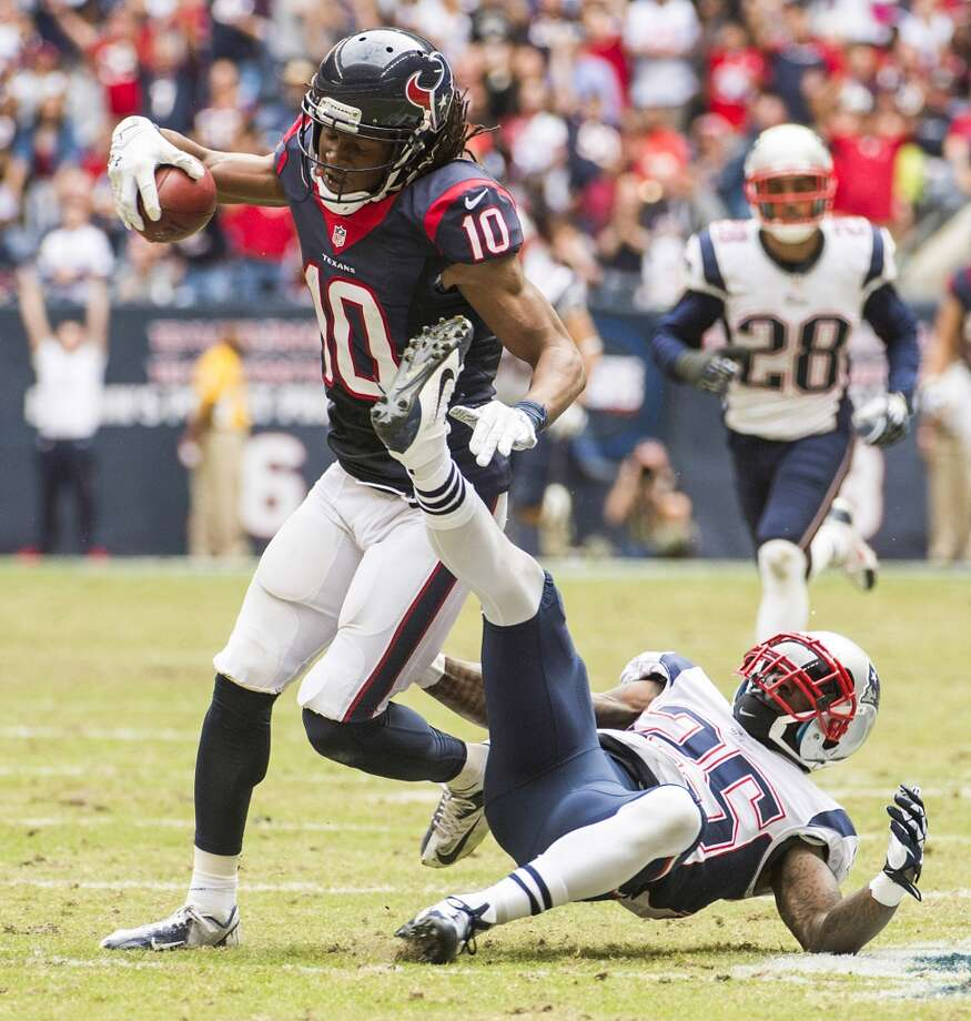 Texans wide receiver DeAndre Hopkins gets past Patriots cornerback Kyle Arrington on a 66-yard pass play. Photo: Smiley N. Pool, Houston Chronicle