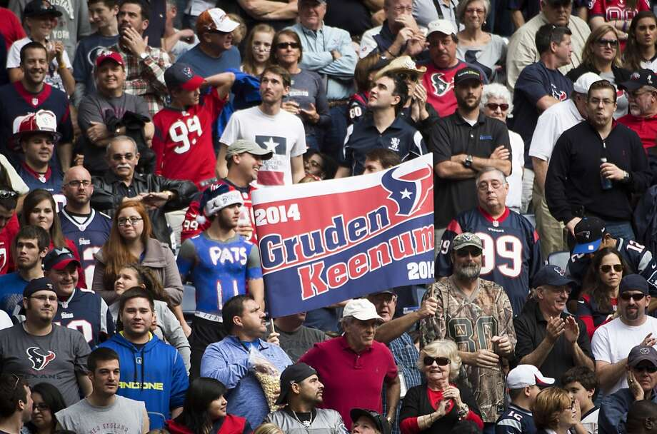 Fans hold up a sign alluding to a pairing of a new coach, former Oakland Raiders and the Tampa Bay Buccaneers coach Jon Gruden, with Texans quarterback Case Keenum during the second half. Photo: Smiley N. Pool, Houston Chronicle