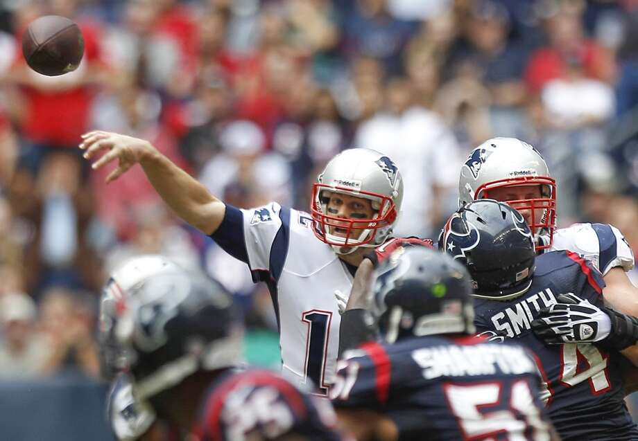 Patriots quarterback Tom Brady throws a pass over the Texans defense during the fourth quarter. Photo: Brett Coomer, Houston Chronicle