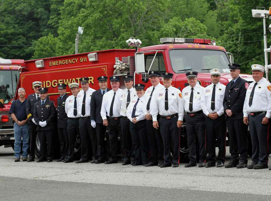 Many members of the Bridgewater Volunteer Fire Department gathered June 11, 2012 for the funeral of past Chief Jim Sullivan. On hand were, from left to right, Glen Foster, unidentified, John Kennedy, past Chief A.J. Murphy, Glen Wilson, Kevin Sullivan, Mike Sullivan, Josh Murphy, Laura Shail, Scott Shail, Howard Hantsch, Rolland Harvey, past Chief Justin Planz, Jim Lillis and past Chief and current president Neil Cable.  Courtesy of Marc Isolda Photo: Contributed Photo / The News-Times Contributed
