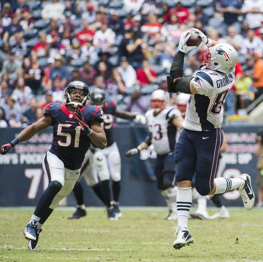 Patriots tight end Rob Gronkowski (87) gets past Texans inside linebacker Darryl Sharpton (51) to haul in a 50-yard pass. Photo: Smiley N. Pool, Houston Chronicle