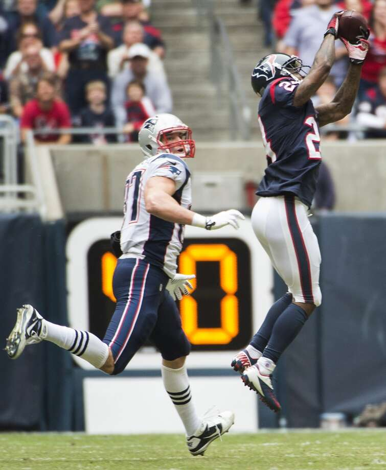 Texans cornerback Johnathan Joseph (24) intercepts a pass intended for Patriots tight end Rob Gronkowski. Photo: Smiley N. Pool, Houston Chronicle