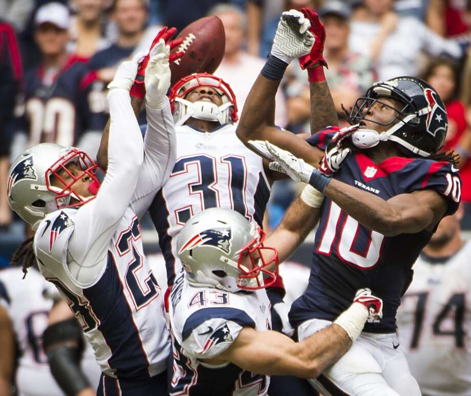 Patriots defensive back Marquice Cole (23) and cornerback Aqib Talib (31) break up a pass intended for Texans wide receiver DeAndre Hopkins. Photo: Smiley N. Pool, Houston Chronicle