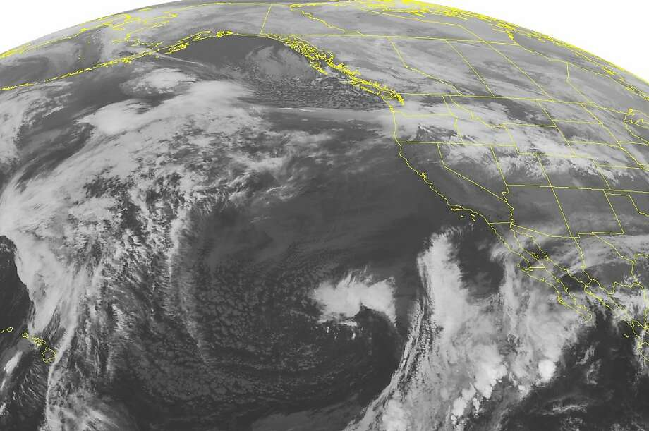 This NOAA satellite image taken Monday, Dec. 2, 2013 at 2:00 a.m. EST shows extensive cloudiness from the northern Plains westward into the Pacific Northwest associated with a large storm system. Photo: Weather Underground, Associated Press