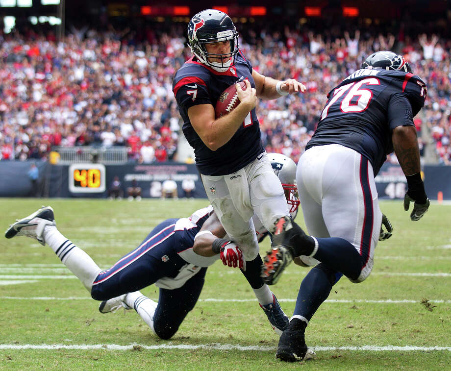 Houston Texans quarterback Case Keenum (7) breaks away from New England Patriots outside linebacker Jamie Collins (91) for a 5-yard touchdown run during the third quarter at Reliant Stadium on Sunday, Dec. 1, 2013, in Houston. Photo: Brett Coomer, Houston Chronicle / © 2013  Houston Chronicle