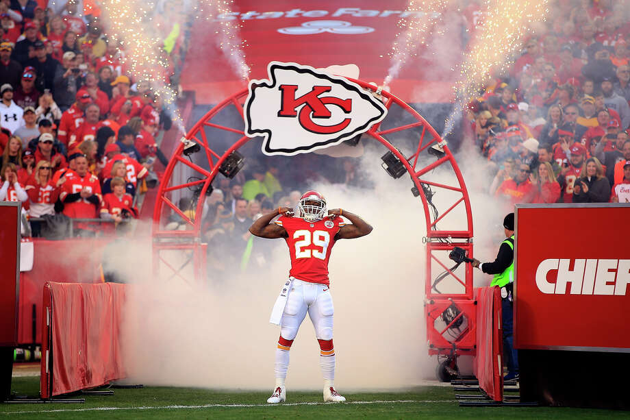 Strong safety Eric Berry #29 of the Kansas City Chiefs runs through a fog machine while he is introduced prior to the game against the Denver Broncos at Arrowhead Stadium on December 1, 2013 in Kansas City, Missouri. Photo: Jamie Squire, Getty Images / 2013 Getty Images