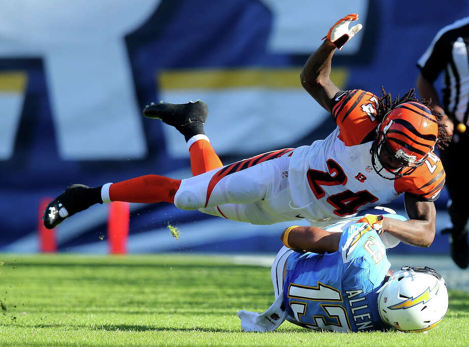 Cornerback Adam Jones #24 of the Cincinnati Bengals makes a tackle against Keenan Allen #13 of the San Diego Chargers at Qualcomm Stadium on December 1, 2013 in San Diego, California. The Bengals won 17-10. Photo: Stephen Dunn, Getty Images / 2013 Getty Images