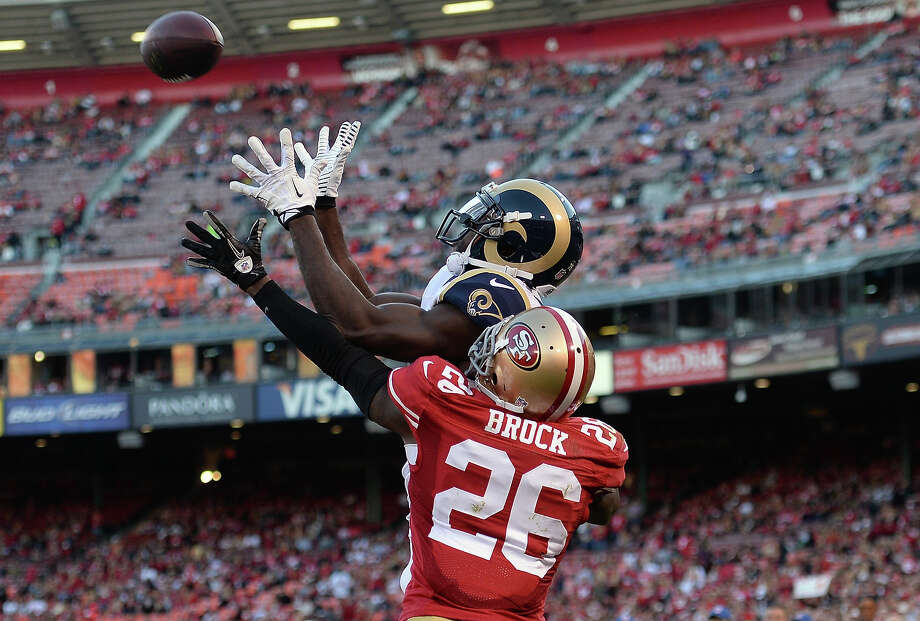 Brian Quick #83 of the St. Louis Rams catches a three yard touchdown pass over Tramaine Brock #26 of the San Francisco 49ers during the fourth quarter at Candlestick Park on December 1, 2013 in San Francisco, California. Photo: Thearon W. Henderson, Getty Images / 2013 Thearon W. Henderson