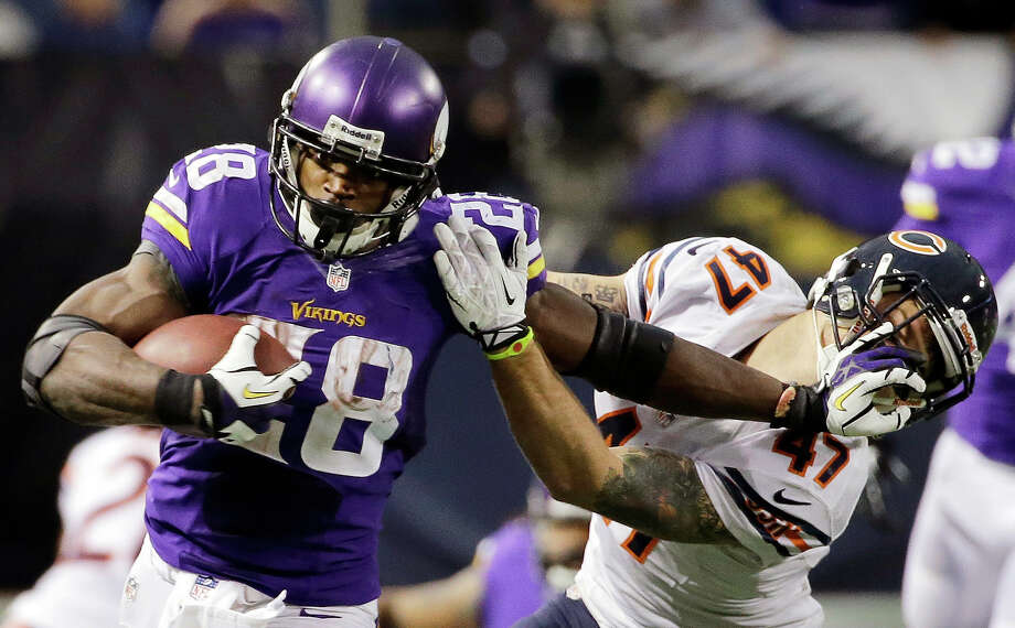 Minnesota Vikings running back Adrian Peterson, left, tries to break a tackle from Chicago Bears free safety Chris Conte during the fourth quarter of an NFL football game on Sunday, Dec. 1, 2013, in Minneapolis. The Vikings won 23-20 in overtime. Photo: Ann Heisenfelt, ASSOCIATED PRESS / AP2013