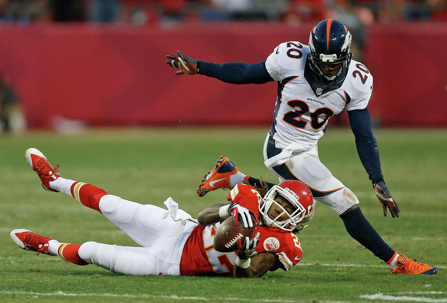 Kansas City Chiefs wide receiver Dexter McCluster (22) makes a catch against Denver Broncos strong safety Mike Adams (20) during the first half of an NFL football game, Sunday, Dec. 1, 2013, in Kansas City, Mo. Photo: Ed Zurga, AP / FR34145 AP