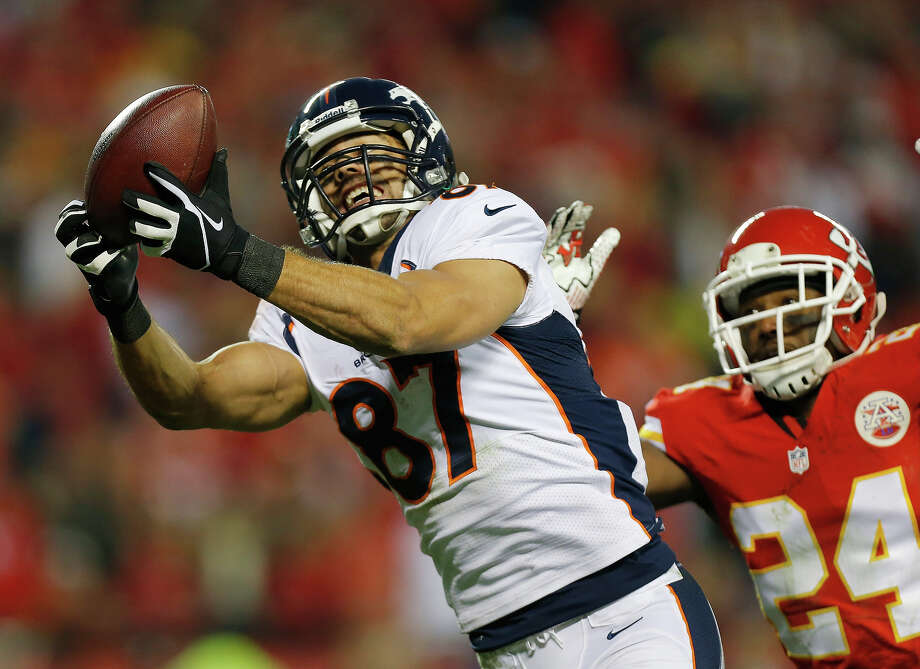 Denver Broncos wide receiver Eric Decker (87) makes a touchdown reception against Kansas City Chiefs cornerback Brandon Flowers (24) during the second half of an NFL football game, Sunday, Dec. 1, 2013, in Kansas City, Mo. Photo: Ed Zurga, ASSOCIATED PRESS / AP2013