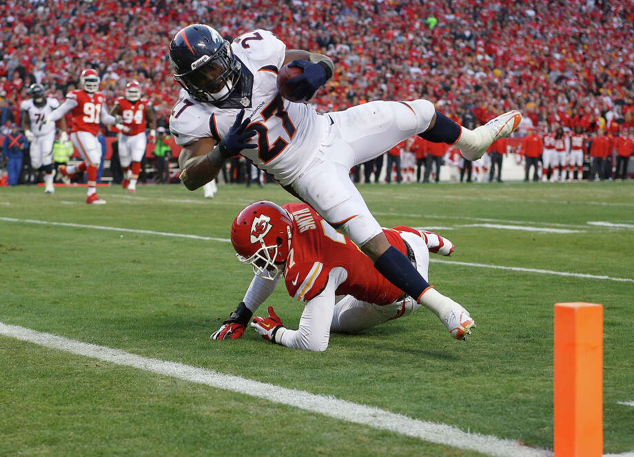 Denver Broncos running back Knowshon Moreno (27) dives into the end zone for a touchdown against Kansas City Chiefs cornerback Sean Smith (27) during the first half of an NFL football game, Sunday, Dec. 1, 2013, in Kansas City, Mo. Photo: Ed Zurga, ASSOCIATED PRESS / AP2013