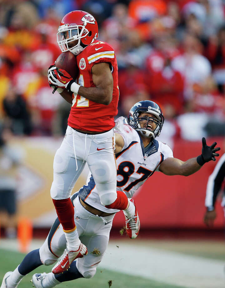 Kansas City Chiefs cornerback Marcus Cooper (31) intercepts a pass intended for Denver Broncos wide receiver Eric Decker (87) during the first half of an NFL football game, Sunday, Dec. 1, 2013, in Kansas City, Mo. Photo: Orlin Wagner, AP / AP