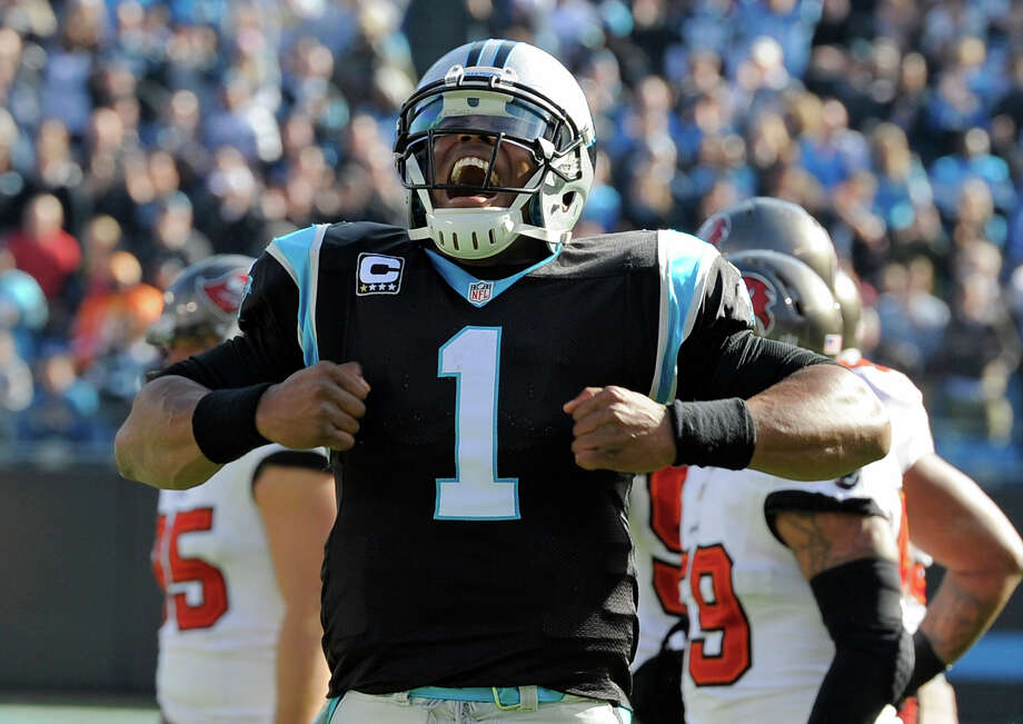 Carolina Panthers' Cam Newton (1) celebrates his touchdown pass against the Tampa Bay Buccaneers in the first half of an NFL football game in Charlotte, N.C., Sunday, Dec. 1, 2013. Photo: Mike McCarn, ASSOCIATED PRESS / AP2013