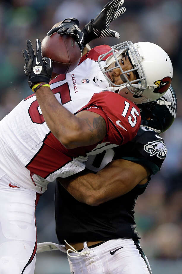 Arizona Cardinals' Michael Floyd pulls in a pass against Philadelphia Eagles' Nate Allen during the second half of an NFL football game, Sunday, Dec. 1, 2013, in Philadelphia. Photo: Matt Rourke, AP / AP