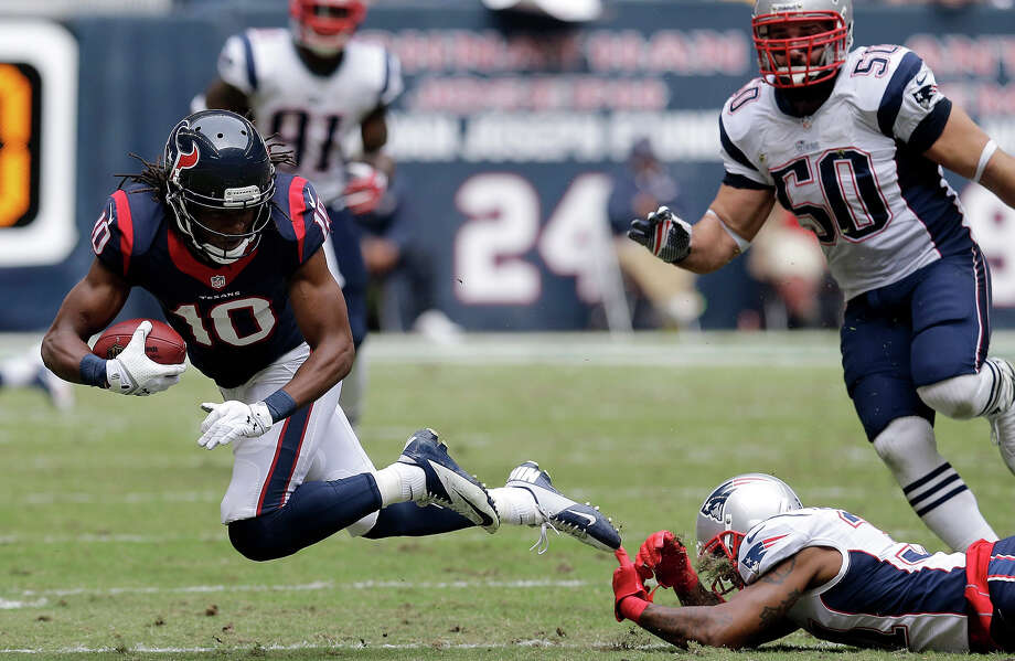 Houston Texans' DeAndre Hopkins (10) is tripped by New England Patriots' Aqib Talib, bottom right, after a reception during the second quarter of an NFL football game on Sunday, Dec. 1, 2013, in Houston. Photo: Patric Schneider, ASSOCIATED PRESS / AP2013
