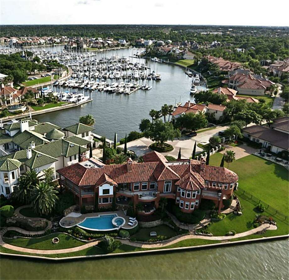 13 Waterford Oaks: This 1998 waterfront estate has 4 bedrooms, 4 full and 2 half bathrooms, 6,584 square feet, and features lake views, his and her garages, and Smart Home technology. Listed for $3,295,000. Contact agent Faye Williams at 281-467-0977 for more information. Photo: HAR.com