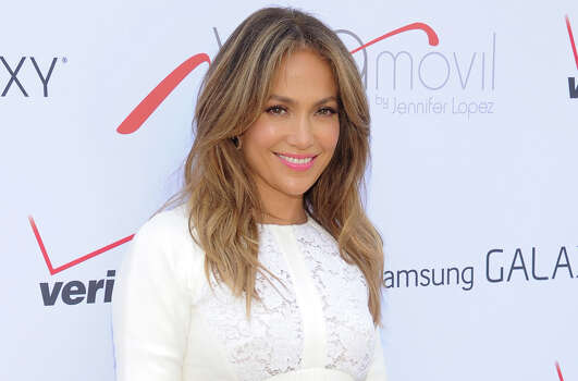 "FILE - This July 26, 2013 file photo shows singer and actress Jennifer Lopez at the ""Viva Movil by Jennifer Lopez"" flagship store grand opening in the Brooklyn borough of New York.  Lopez, the 44-year-old mother of 5-year-old twins, Maximilian and Emme, will receive the Grace Kelly Award at the March of Dimes luncheon at the Beverly Hills Hotel on Friday, Dec. 6, 2013. She's being recognized as a celebrity parent role model supporting women giving birth to healthy babies after full-term pregnancies.(Photo by Evan Agostini/Invision/AP, File) Photo: Evan Agostini, Associated Press / Invision"