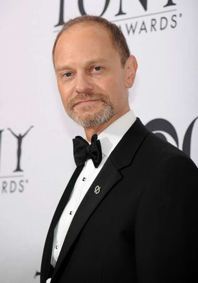 "David Hyde-Pierce: After hit show Frasier debuted, Hyde-Pierce claimed ""Basically I don't talk about my personal life."" Then after years of pressure from the gay press, he came out through his publicist and confirmed his long-time relationship with a producer/director. (Photo by Bryan Bedder/Getty Images)"