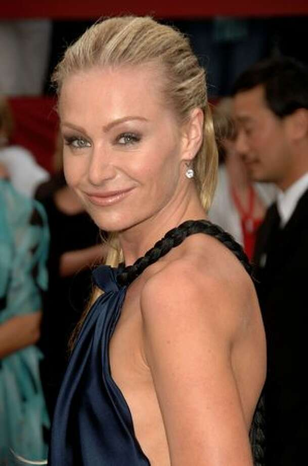 Portia de Rossi, actress, formerly on Ally McBeal: Portia de Rossi was outed by a tabloid when the mag published pictures of her with then-girlfriend Francesca Gregorini. Subsequently, de Rossi married talk show host Ellen DeGeneres. (Photo by Stephen Shugerman/Getty Images)