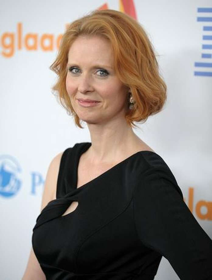 "Cynthia Nixon, actress, Sex and the City's Miranda Nixon, when first asked about her relationship, said ""My private life is private. But at the same time, I have nothing to hide. So what I will say is that I am very happy."" Her partner was soon outed as community organizer Christina Marinoni. (Photo by Andrew H. Walker/Getty Images)"