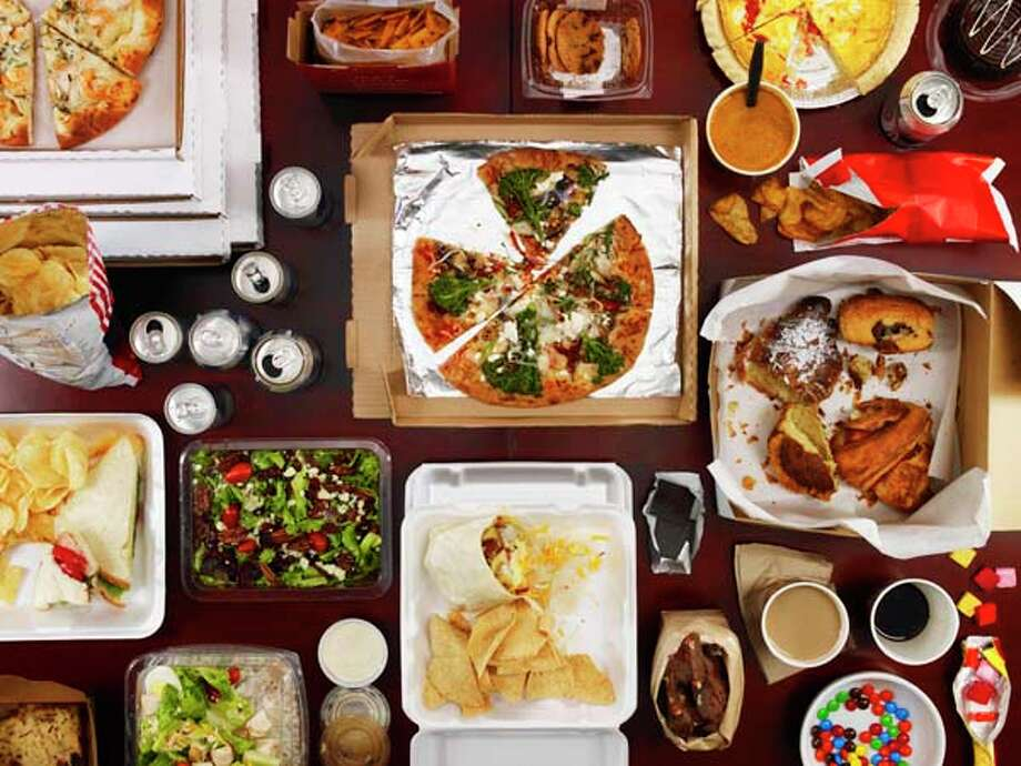Step. Away. From. The. Food. Table. No, seriously. Hanging out near the food is just asking for it. No one's willpower is THAT good. Photo: Dwight Eschliman, Getty Images / (c) Dwight Eschliman