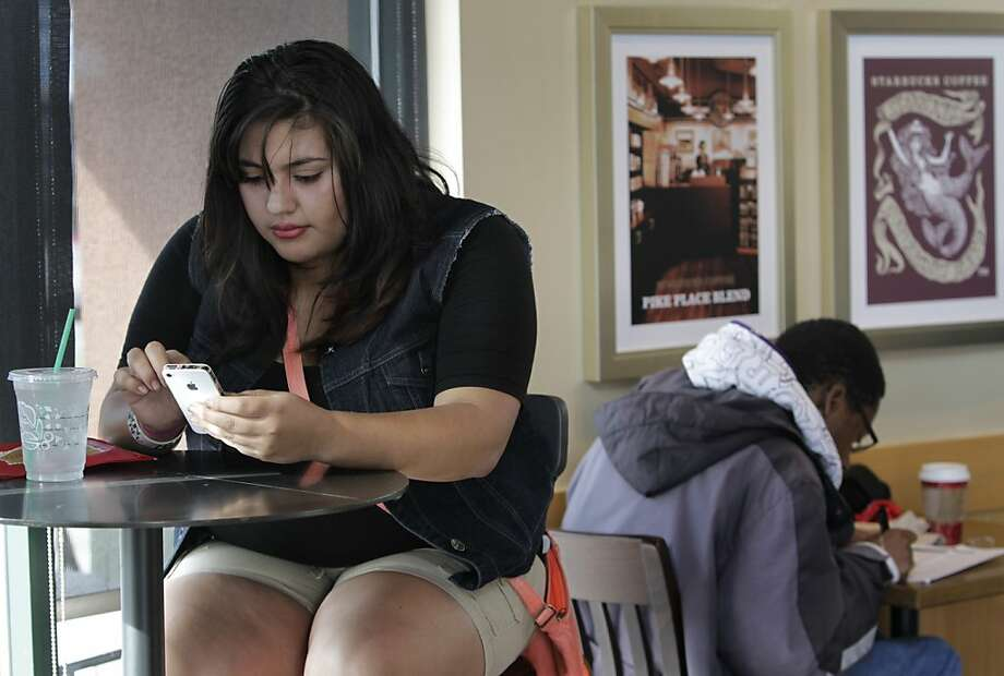 Maria Barragan accesses her MyHeartIt social network page on her smart phone in San Pablo, Calif. on Wednesday, Nov. 27, 2013. More and more teens are ditching Facebook for alternative social networking sites. Photo: Paul Chinn, The Chronicle