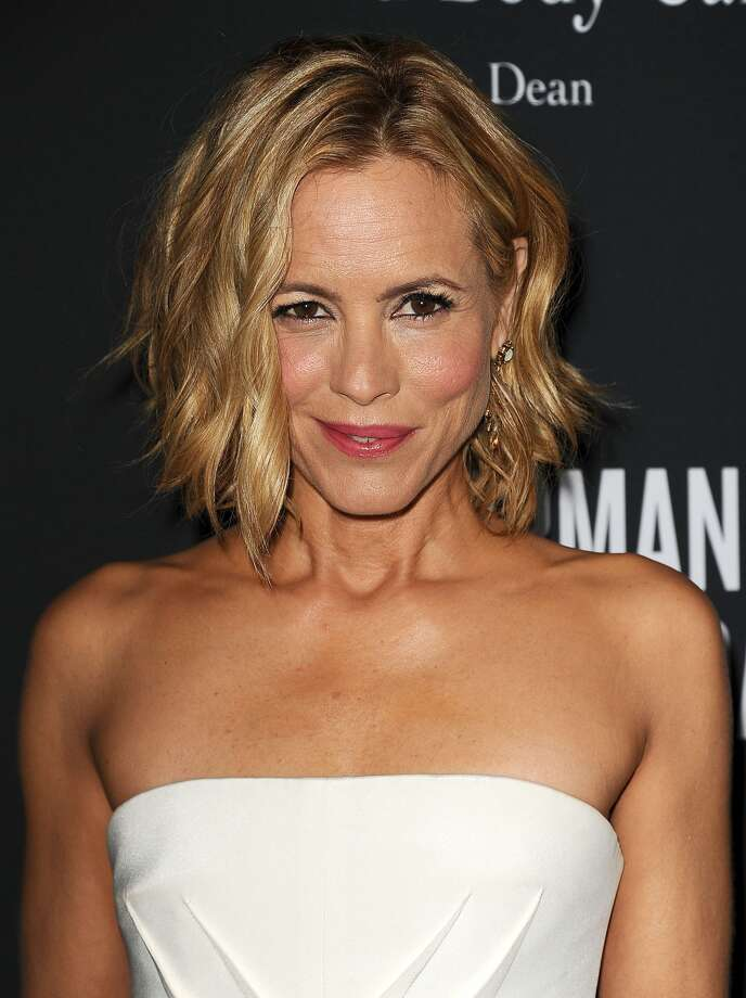 """Actress Maria Bello has revealed she's in a relationship with a woman ina heartfelt article for the New York Times.The star wrote a piece for the newspaper on Friday, Nov. 27, 2913, recalling the moment she came out to her 12-year-old son, Jackson, who asked her if she was in a relationship with anyone.In the article, titled """"Coming Out as a Modern Family,"""" she writes, """"I was with someone romantically and I hadn't told him. I had become involved with a woman who was my best friend, and, as it happens, a person who is like a godmother to my son."""""""