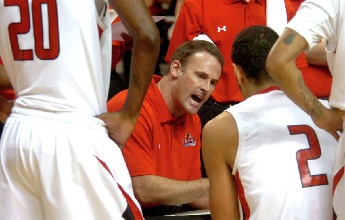 Lamar coach, Pat Knight talks to the team during a time out during the game against Huston-Tillotson at the Montagne Center at Lamar in Beaumont, Wednesday, December 14, 2011. Tammy McKinley/The Enterprise
