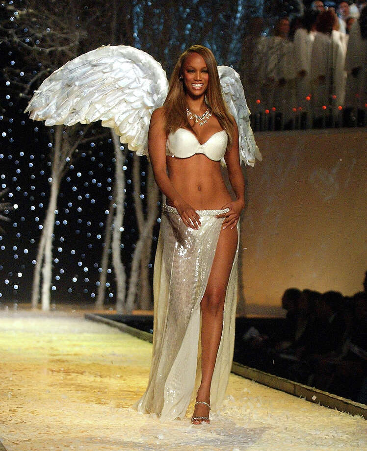 Tyra Banks wearing embellished Victoria's Secret body bare lightly lined demi at the Victoria's Secret Fashion Show in 2001. Photo: KMazur, WireImage / WireImage