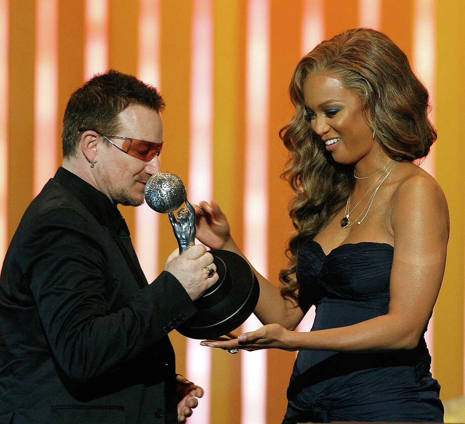 "Model/TV Host Tyra Banks (R) presents the ""Chairman's Award"" to Bono onstage during the 38th annual NAACP Image Awards held at the Shrine Auditorium on March 2, 2007 in Los Angeles. Photo: Vince Bucci, Getty Images / 2007 Getty Images"