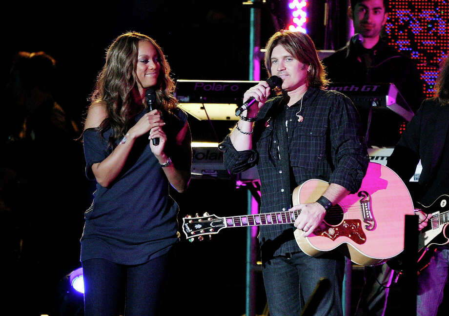 "Model Tyra Banks (L) and singer Billy Ray Cyrus appear onstage at Miley Cyrus' ""Sweet 16"" birthday celebration benefiting Youth Service America at Disneyland on October 5, 2008 in Anaheim, California. Photo: Kevin Winter, Getty Images / 2008 Getty Images"