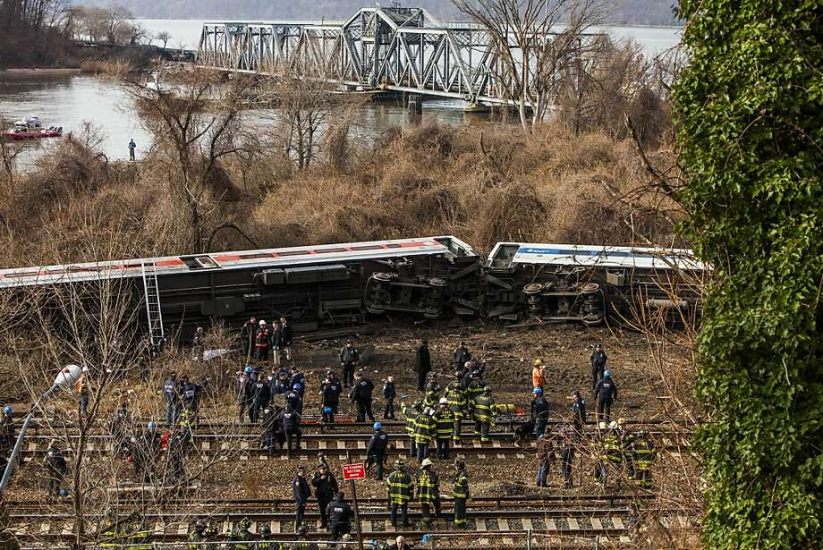 Much too fast:Emergency crews treat injured passengers after a Metro-North train derailed near the Spuyten Duyvil station in   the Bronx borough of New York City. Four people were killed and 67 injured when the seven-car train careened off the tracks as it was heading to Grand Central Terminal. Federal investigators said the train was traveling at 82 mph into a 30-mph curve. Photo: Christopher Gregory, Getty Images