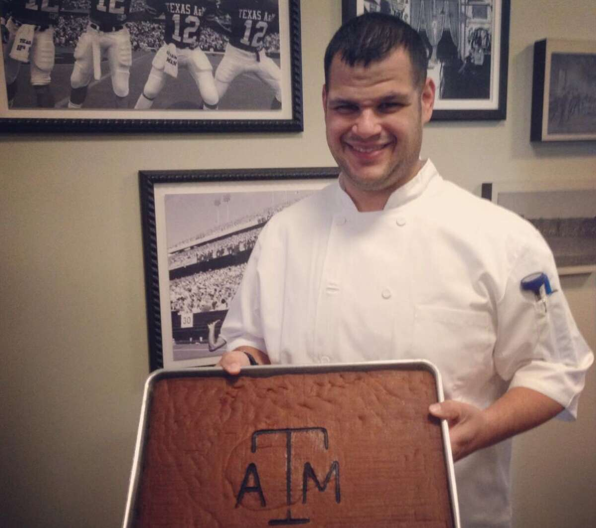 The first Aggie gingerbread brick of the 3,600 needed to cover the entire house.(Texas A&M Traditions Club photos)