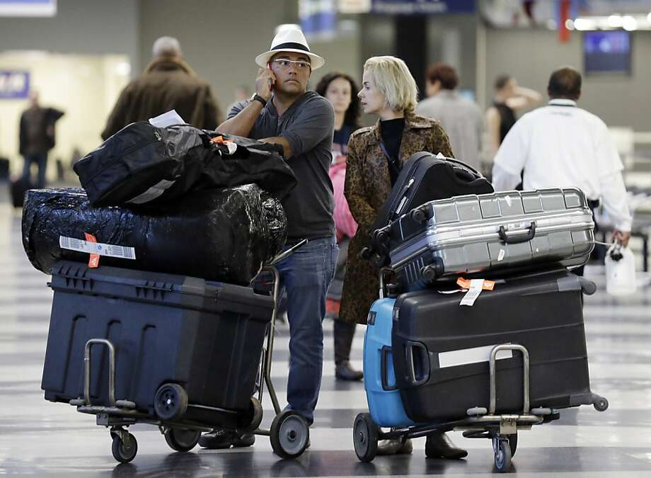 And I thought I was the queen of excessive luggage:Travelers returning from the Thanksgiving holiday collect their bags at O'Hare International in Chicago. Photo: Nam Y. Huh, Associated Press