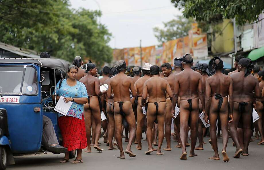 Cross buns:In Colombo, underdressed Sri Lankan farmers march in Colombo to protest the government's failure to   address their long-standing grievances. Photo: Eranga Jayawardena, Associated Press