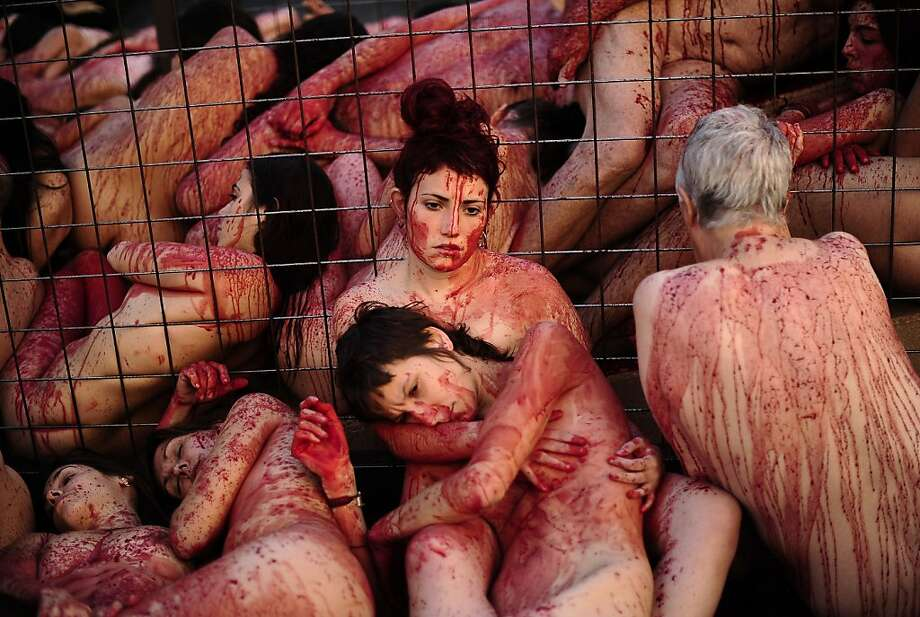 Covered with fake blood, naked animal-rights activists of Anima Naturalis lie in Barcelona's Sant Jaume Square to protest the use of leather and fur in Spain's textile industry. Photo: Josep Lago, AFP/Getty Images