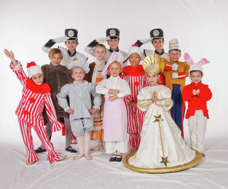 "Darien residents performing in the Connecticut Ballet's production of ""The Nutcracker"" are, in front row from left, Megan Case, Katherine Drugge, Phoebe Bryan, Anastassia Grytsenko and Katie Cutler; middle row, Tate Hanson, Sophie Hill, Ping Ryan and Chase Hanson; back row, Jordan Cassetta, Elena Uttley and Ashley Cassetta. Photo: Contributed Photo, Contributed / Darien News"