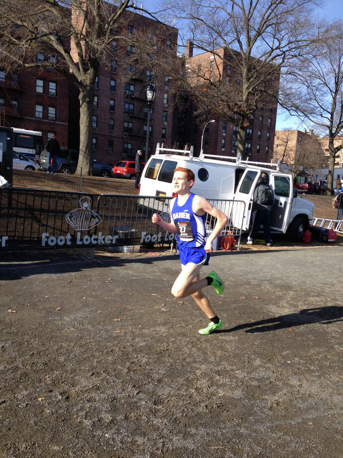 Darien's Alex Ostberg competes at the Foot Locker Northeast Regional championship race on Saturday, Nov. 30, 2013 at Van Cortlandt Park in the Bronx. Ostberg finished in 15:22.5. Photo: Contributed Photo / Darien News