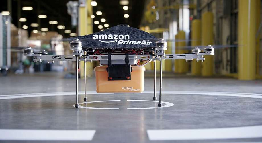 "This undated handout photo released by Amazon on December 1, 2013 shows an ""octocopter"" mini-drone that would be used to fly small packages to consumers. Amazon CEO Jeff Bezos revealed on December 1 that his company was looking to the future with plans to use mini-drones to deliver small packages. AFP PHOTO / AMAZON  --- EDITORS NOTE --- RESTRICTED TO EDITORIAL USE - MANDATORY CREDIT ""AFP PHOTO / AMAZON "" - NO MARKETING NO ADVERTISING CAMPAIGNS - DISTRIBUTED AS A SERVICE TO CLIENTSAMAZON/AFP/Getty Images Photo: Amazon, AFP/Getty Images"