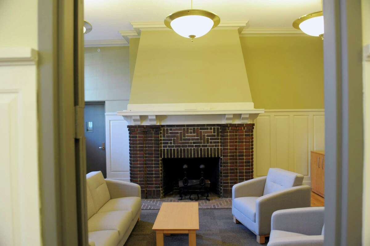 A view of a small parlor with a fire place off the main conference room at The Sage Colleges armory on Monday, Nov. 25, 2013 in Albany, NY. (Paul Buckowski / Times Union)