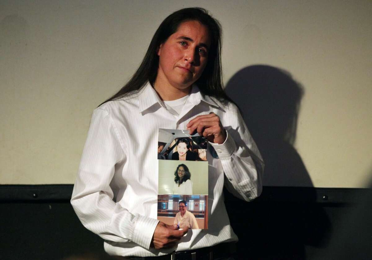 """Anna Vasquez, recently released on parole, holds photos of friends Cassandra Rivera, Kristie Mayhugh, and Elizabeth Ramirez, as she speaks at a Work-In-Progress screening of """"San Antonio Four"""" a documentary by Deborah S. Esquenazi, about Vasquez and her friends, who are still in prison, found guilty of sexual assault of two minors. Thursday, Nov. 15, 2012. (Photo by Bob Owen/Express-News)"""